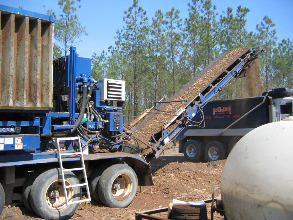 Forest harvest debris being transported and processed for use as substrate3
