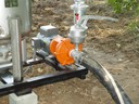 Drip irrigation sand filter priming pump for use with surface water.