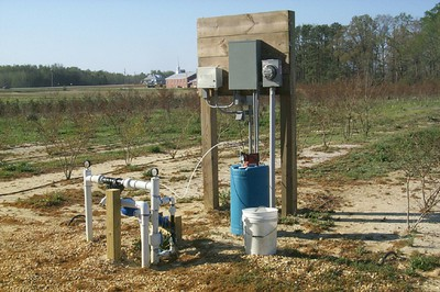 Irrigation station that filters water and injects acid for use in drip system irrigation
